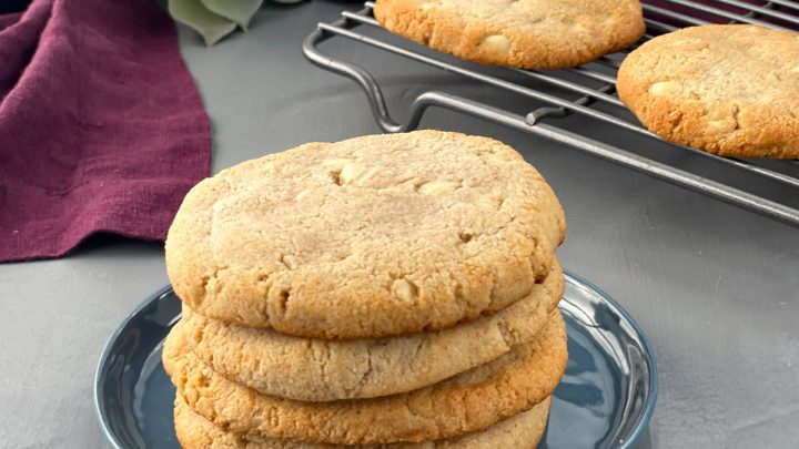 keto macadamia nut cookies stacked on a plate