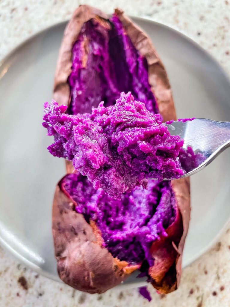 a spoonful of fully cooked Stokes purple sweet potato