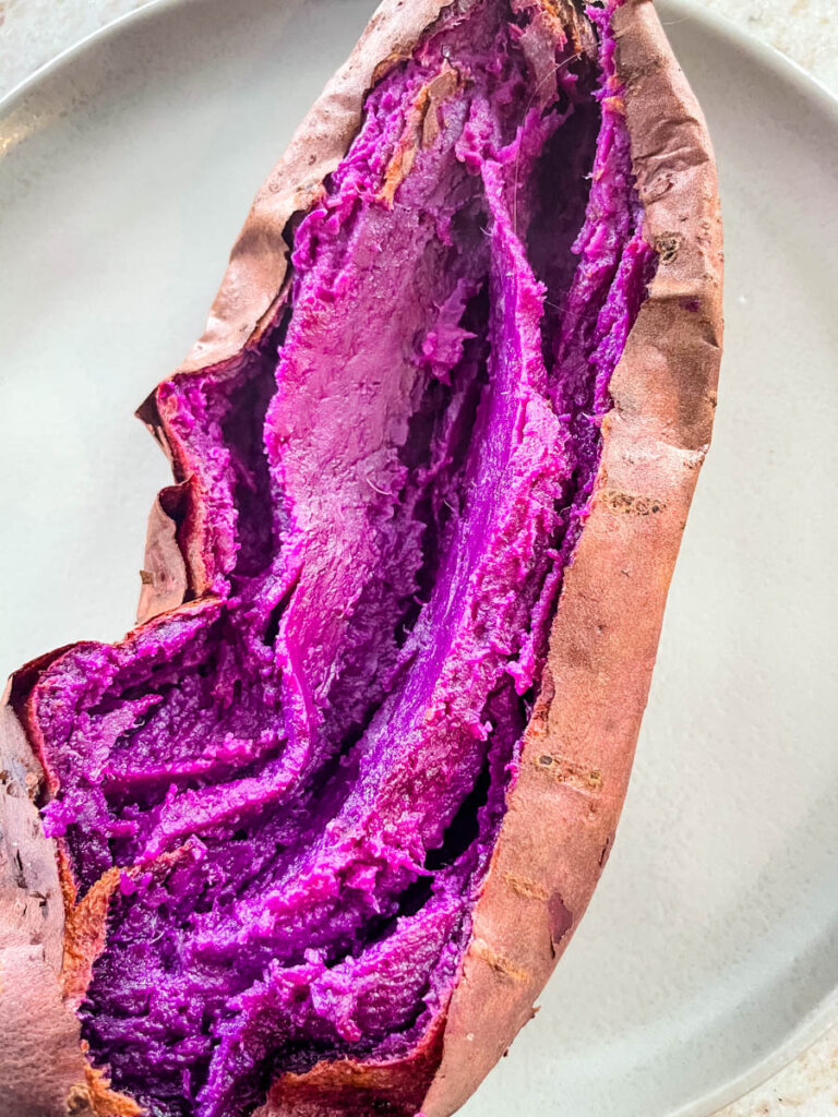 Stokes purple sweet potato fully cooked and sliced open on a plate