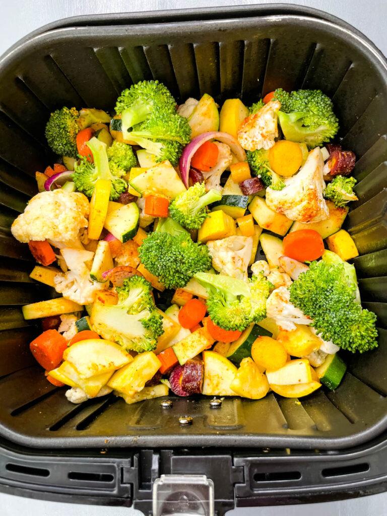 squash, zucchini, onions, carrots, broccoli, and cauliflower in an air fryer