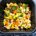 squash, zucchini, onions, carrots, broccoli, and cauliflower in an air fryer