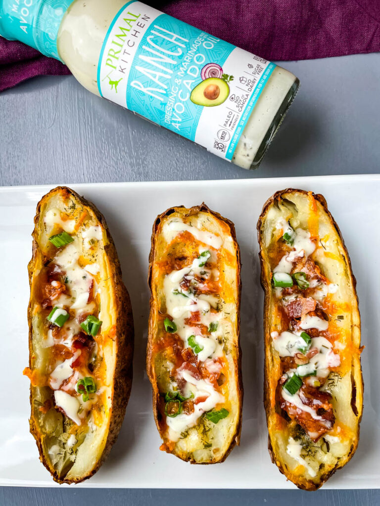 air fryer potato skins drizzled in ranch
