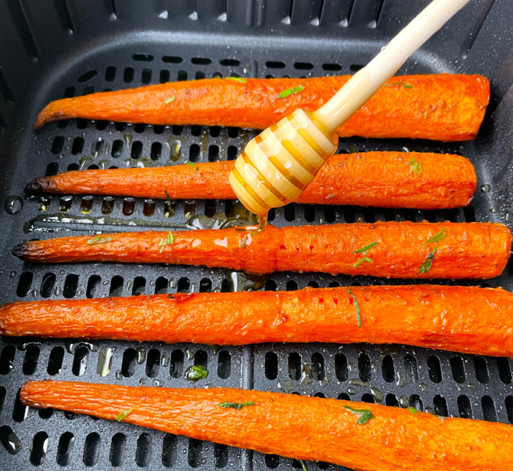roasted carrots in an air fryer glazed with honey