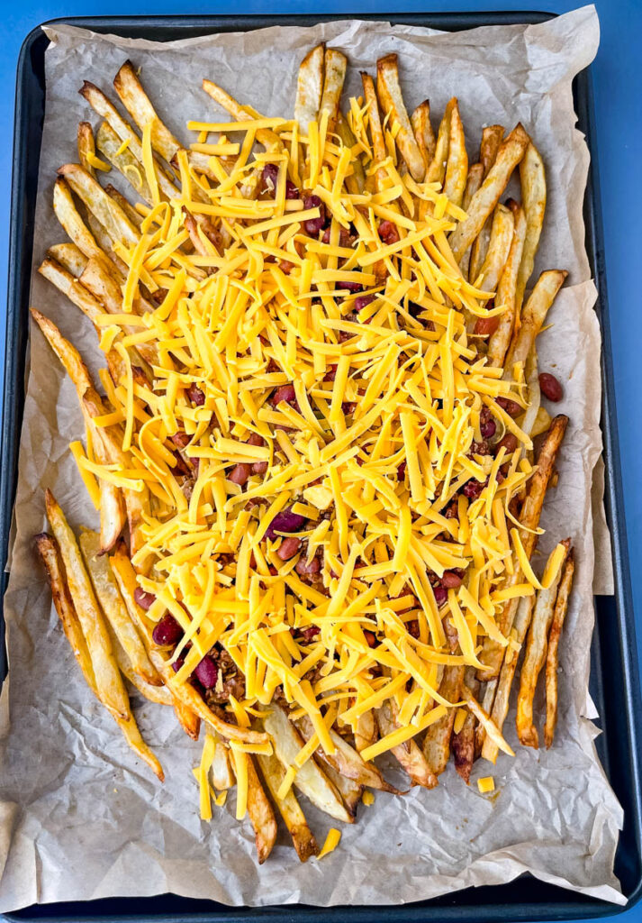 chili cheese fries on a sheet pan