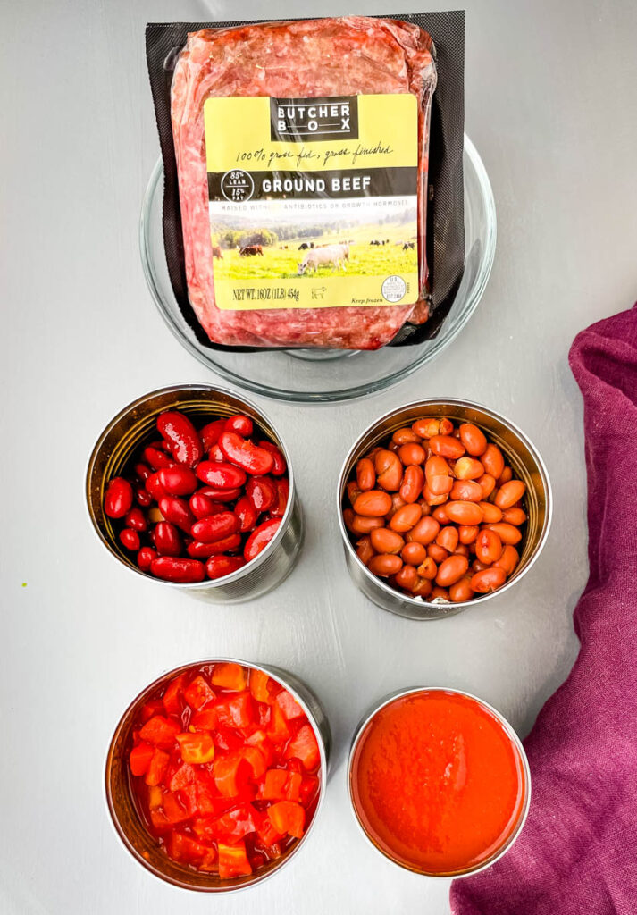 ground beef, beans, diced tomatoes, and tomato sauce in separate containers