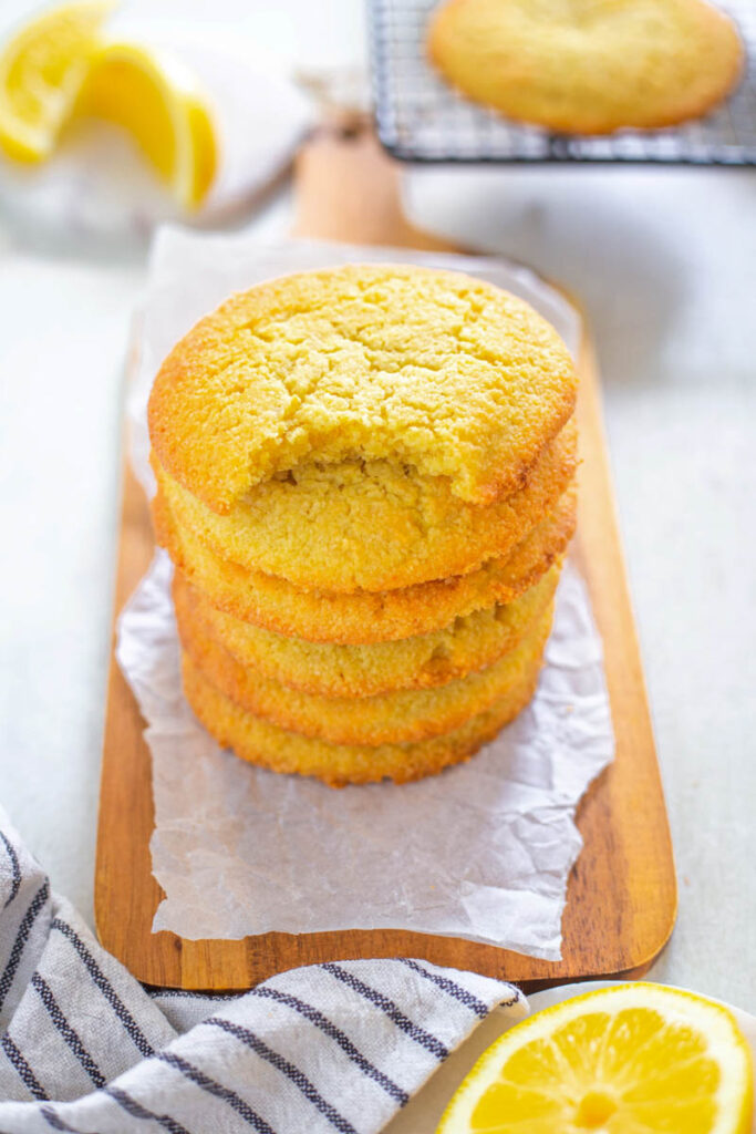 a stack of keto low carb lemon cookies, one on type with a bite taken out