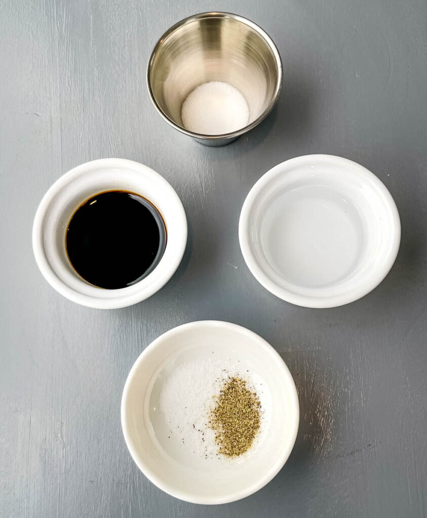 soy sauce, rice vinegar, sweetener, and salt and pepper in separate bowls