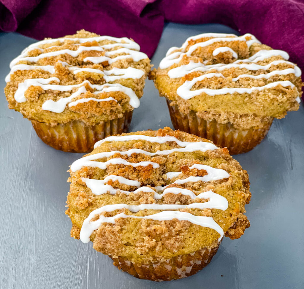 coffee cake muffins with icing on a flat surface