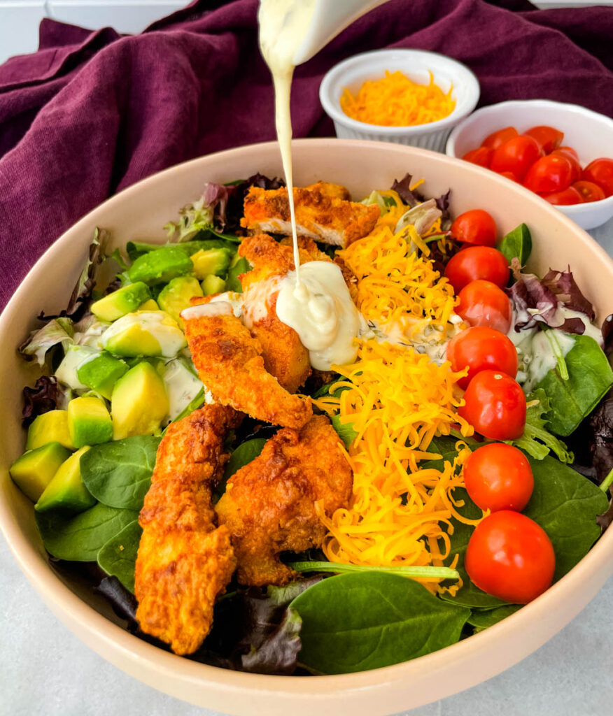 fried chicken salad drizzled in ranch dressing