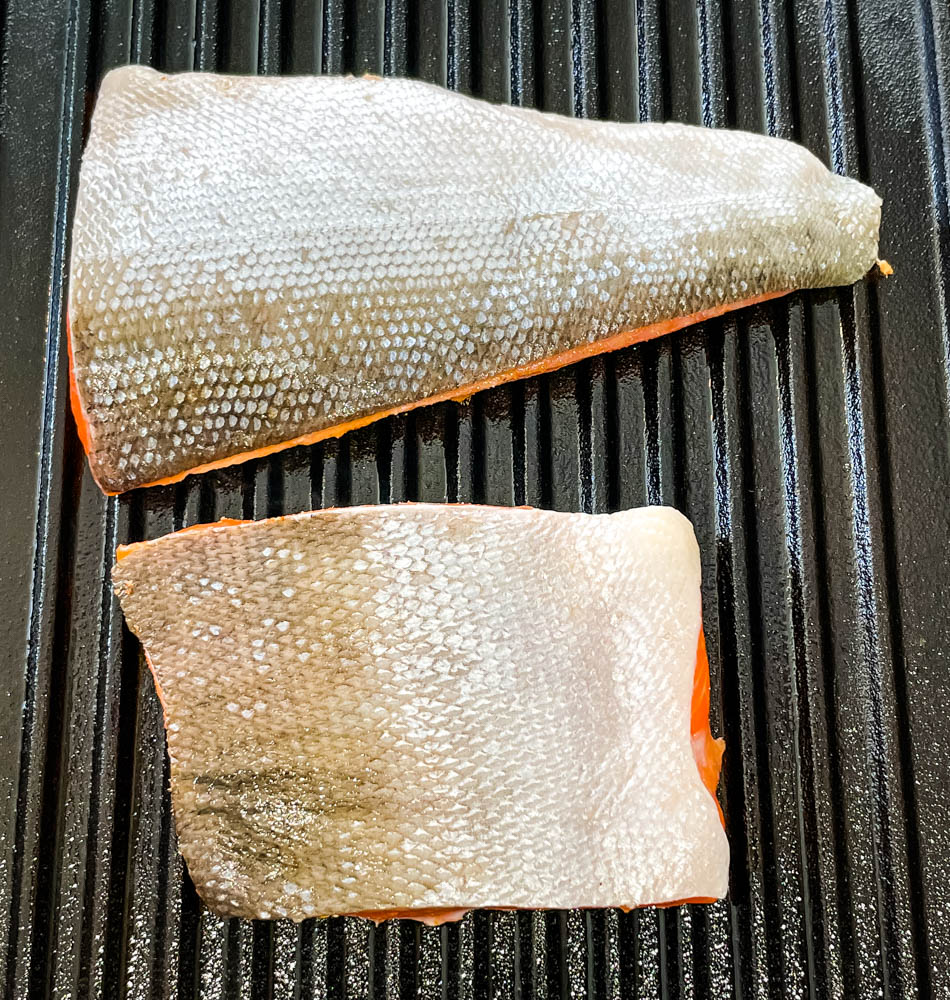 raw wild caught salmon cooked in a grill pan
