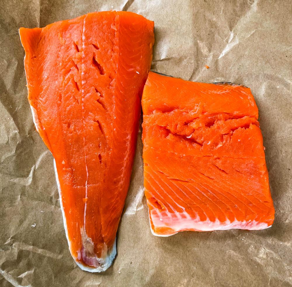 raw wild caught salmon on paper