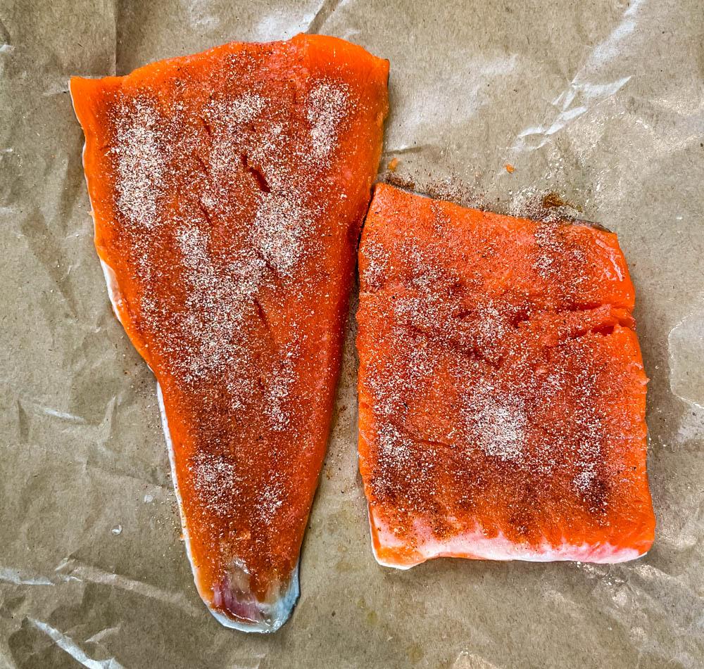 seasoned raw wild caught salmon on paper