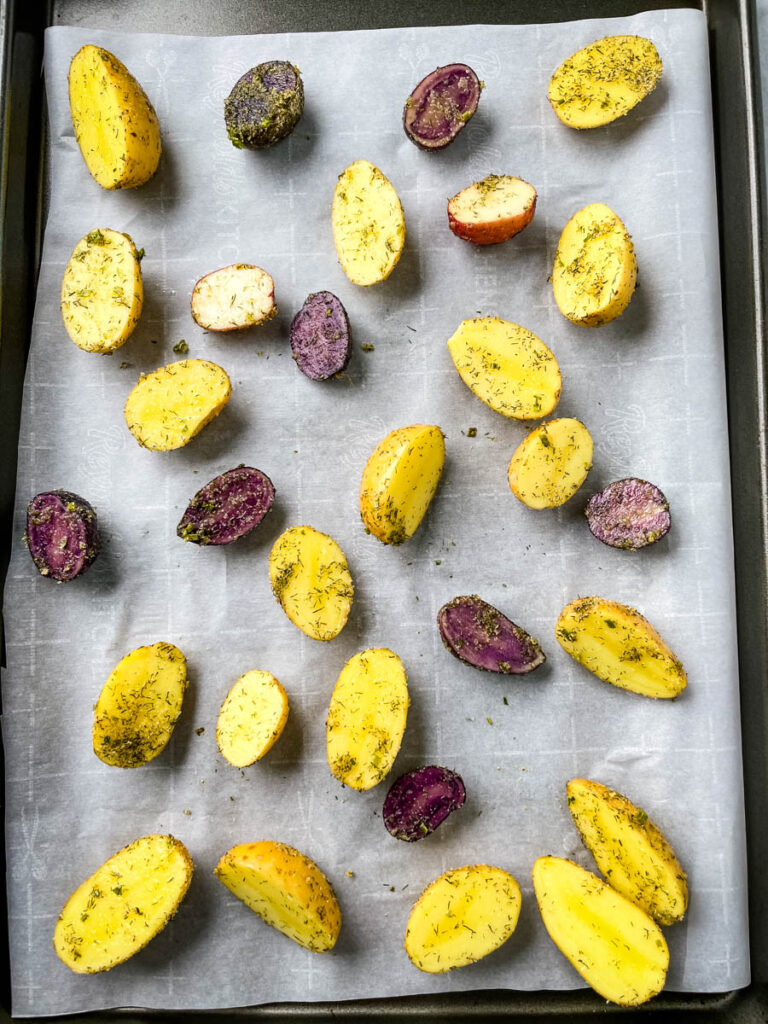 raw potatoes on a sheet pan