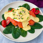 smoked salmon eggs Benedict on a bed of spinach
