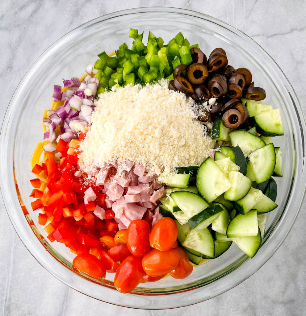 spaghetti salad and vegetables in a glass bowl