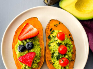 sweet potato avocado toast on a plate with fresh fruit
