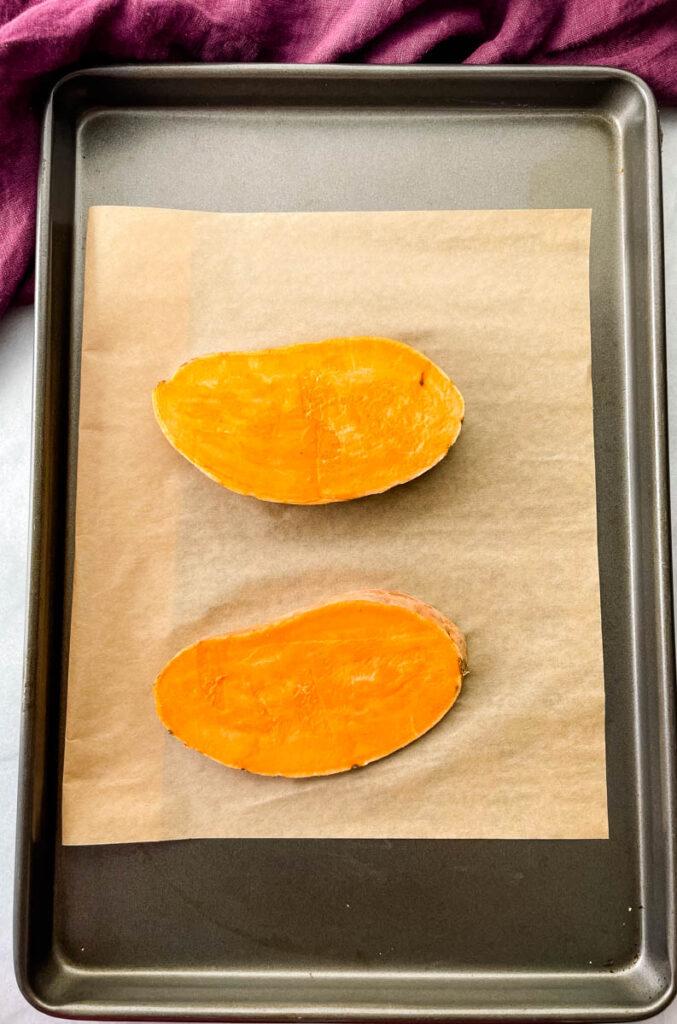 sliced sweet potatoes on a. sheet pan