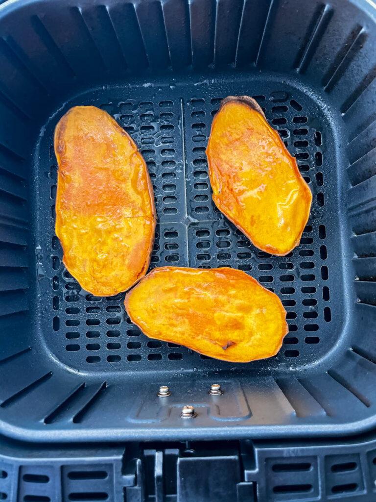 sliced sweet potatoes in an air fryer