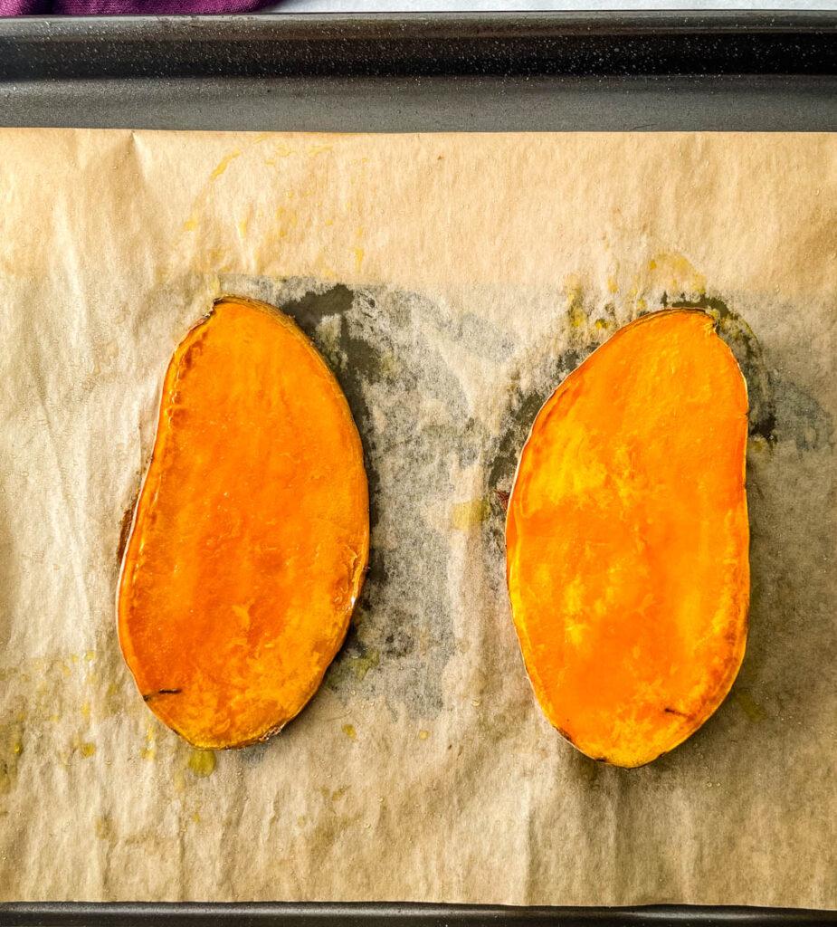 sliced baked sweet potatoes on a sheet pan