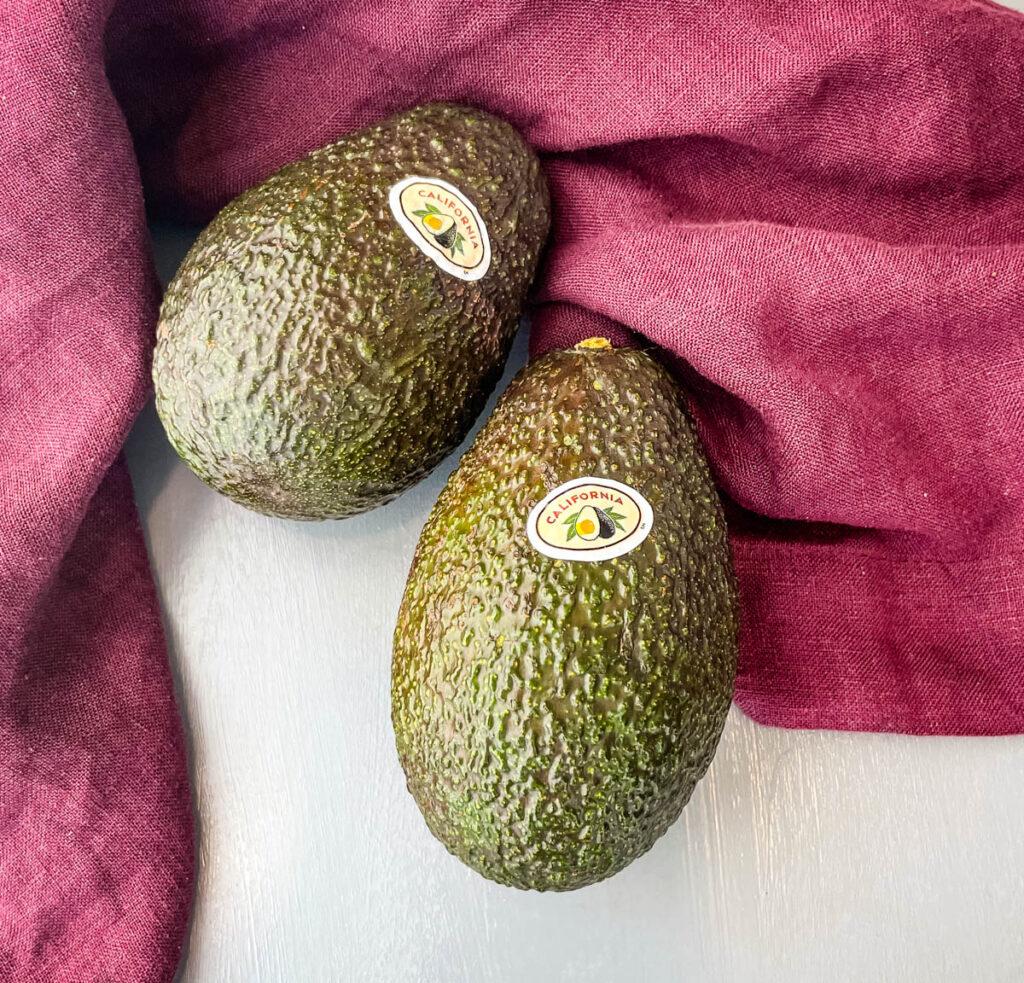 fresh unpeeled avocados