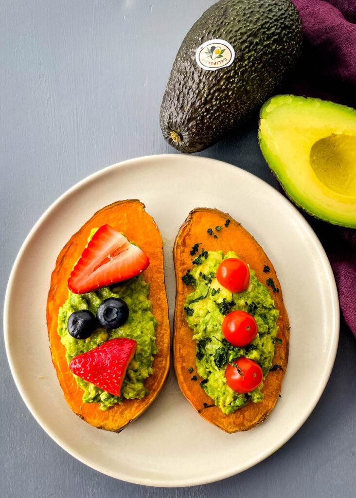 sweet potato avocado toast on a plate with fresh fruit