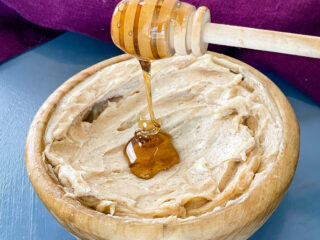 maple butter in a bowl drizzled with maple syrup