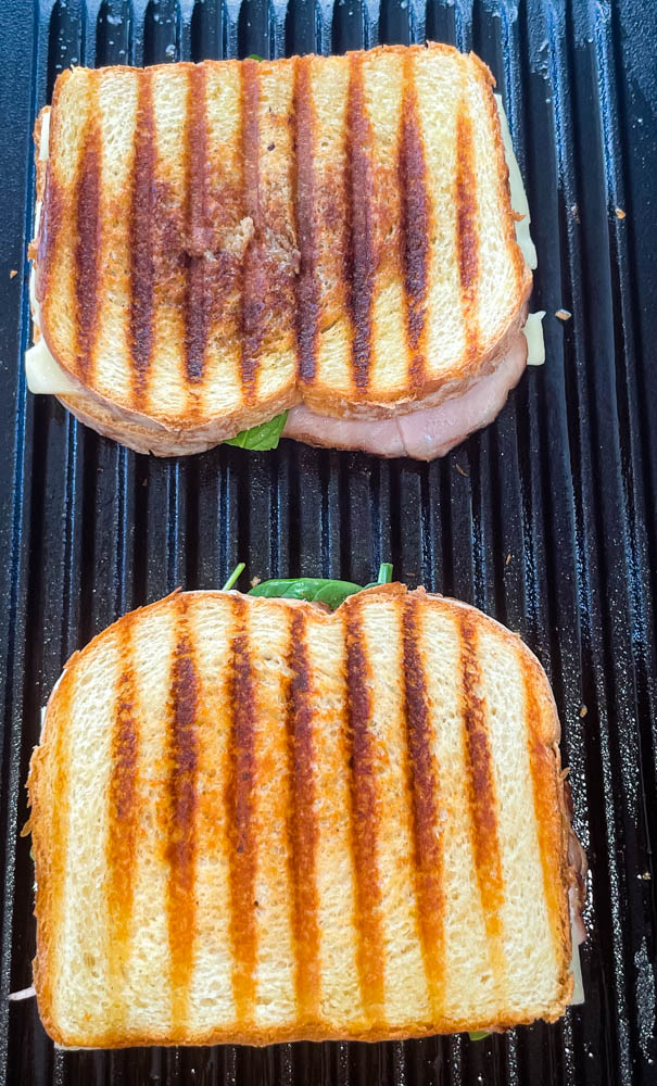 ham and cheese panini sandwich on a grill pan