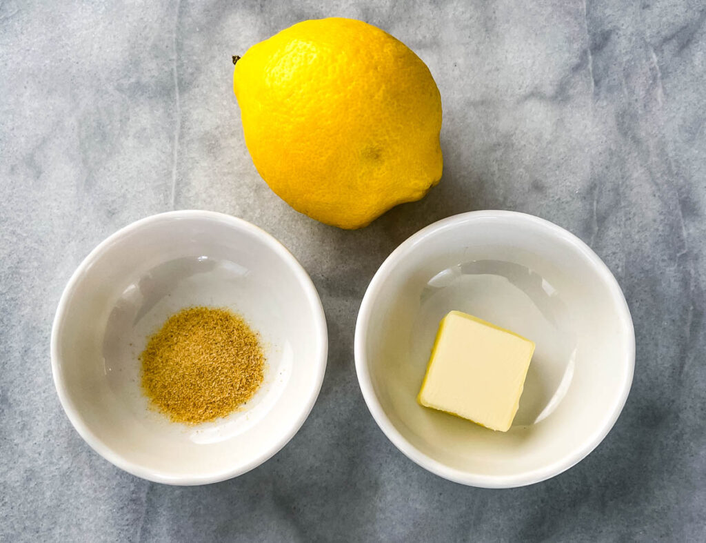 fresh lemon, butter, and seasoning in separate bowls