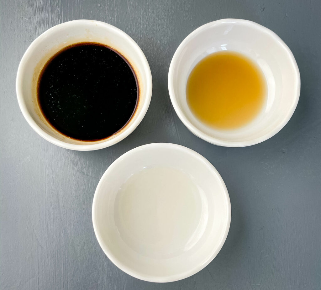 soy sauce, sesame oil, and rice wine vinegar in separate bowls