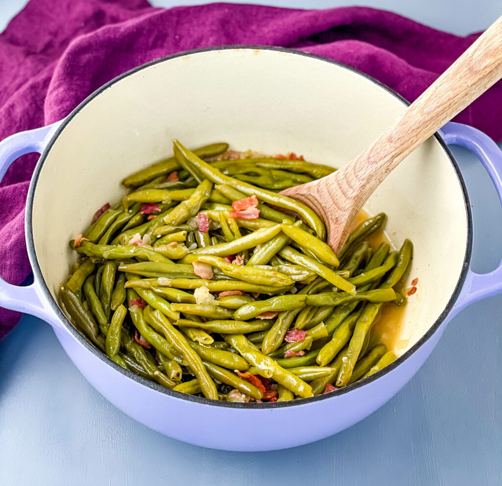 southern green beans in a purple Dutch oven