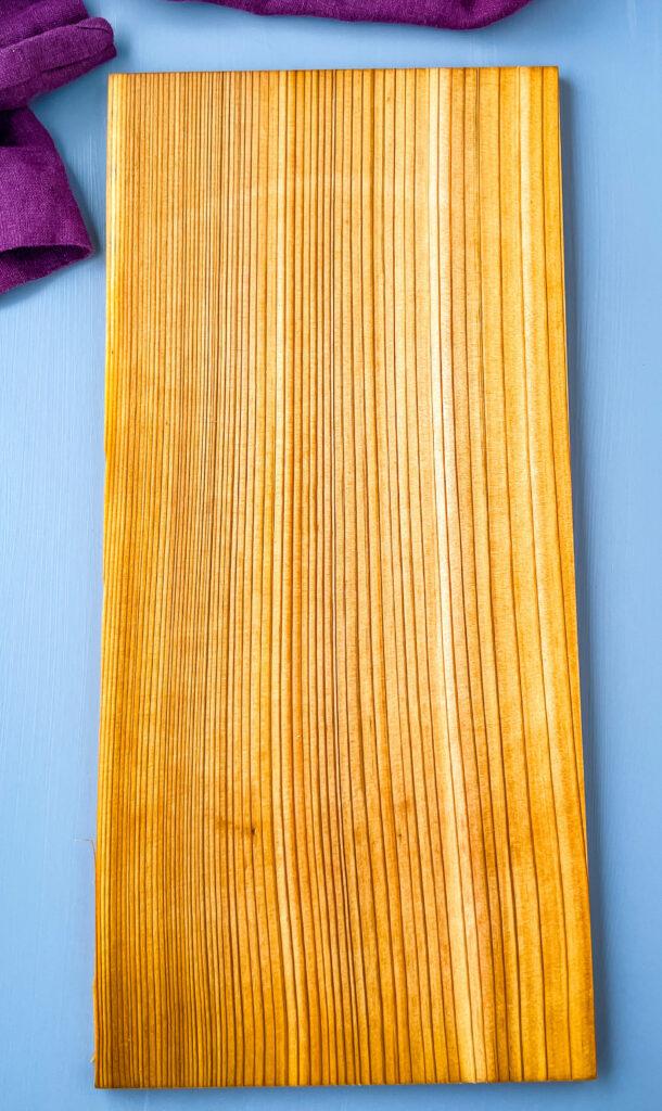a cedar plank on a flat surface