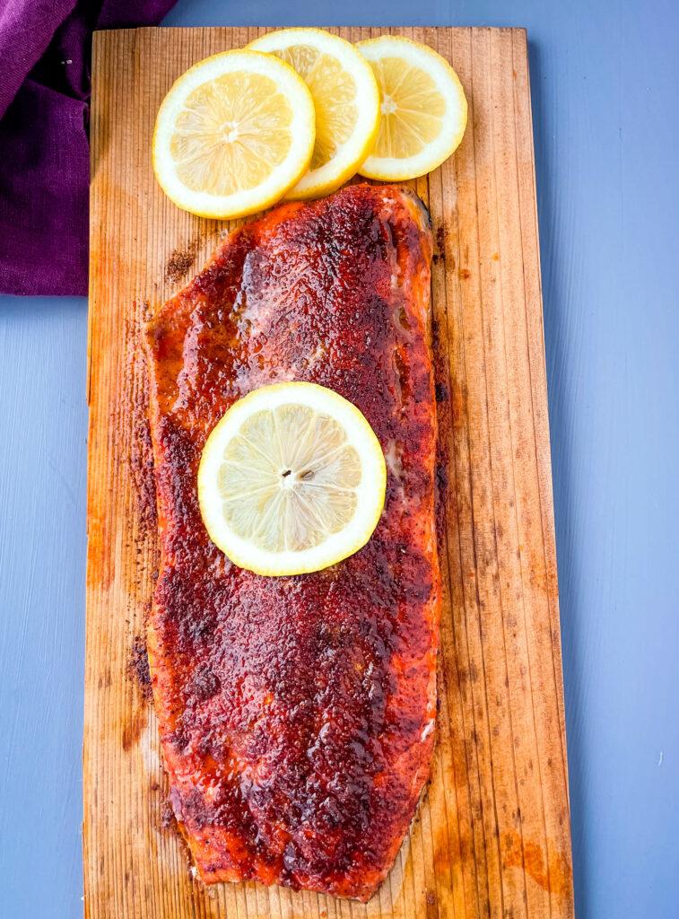 grilled salmon on a cedar plank with lemon