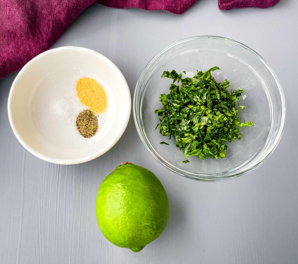 fresh chopped cilantro, a fresh lime, garlic powder, salt, and pepper in separate bowls
