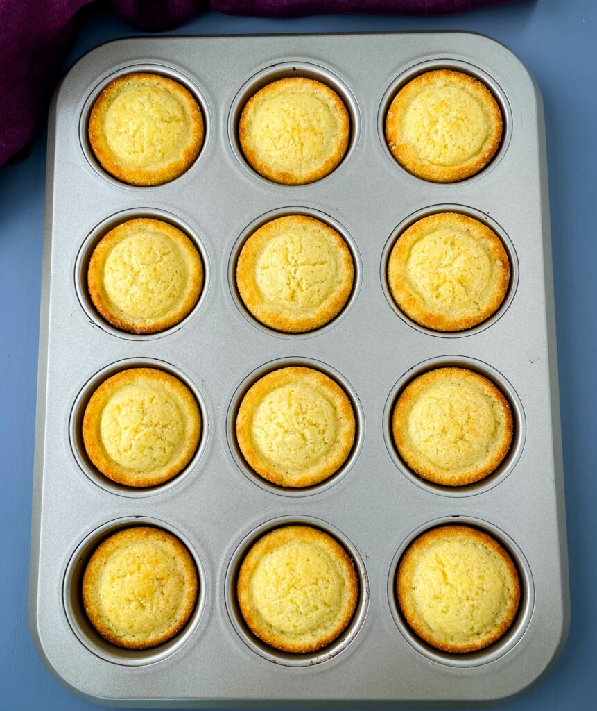 baked cornbread muffins in a muffin tin
