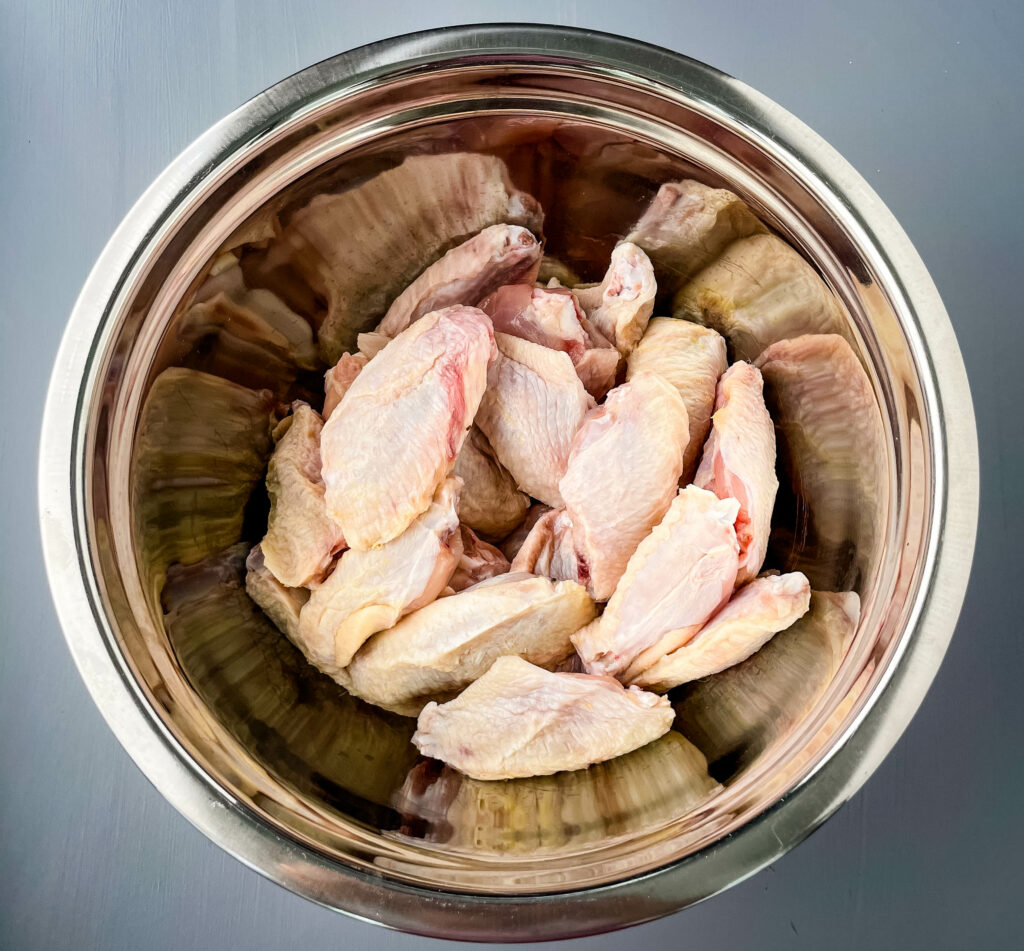 raw chicken wings in a large bowl