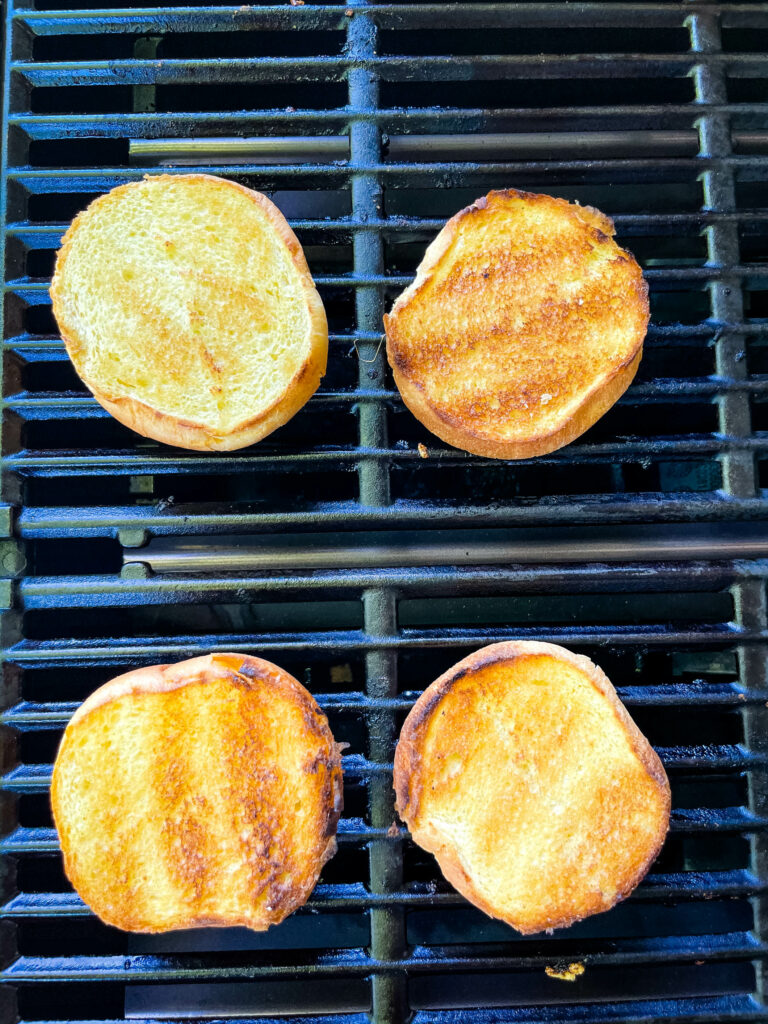 toasted brioche buns on a grill