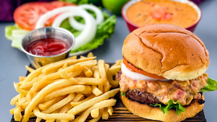 queso burgers on plate with French fries