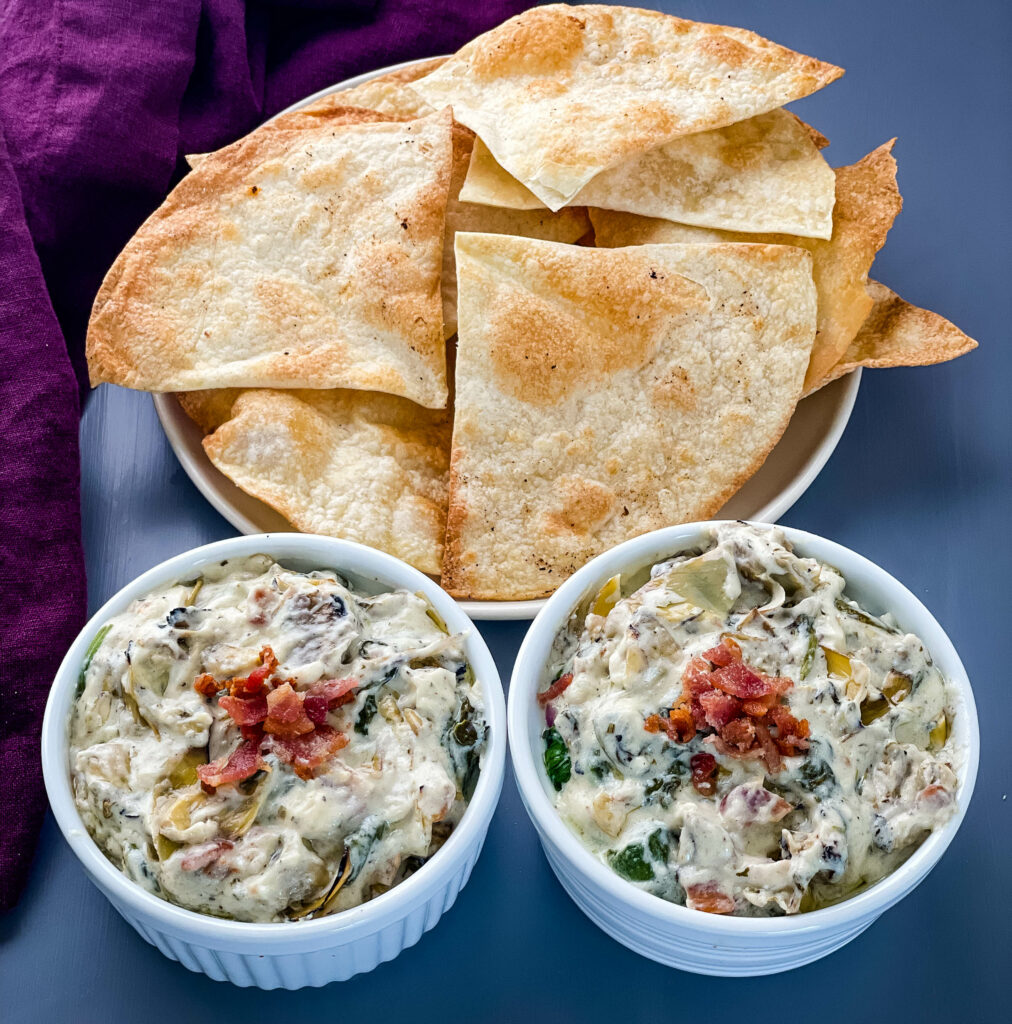 bacon spinach artichoke dip in separate bowls with chips
