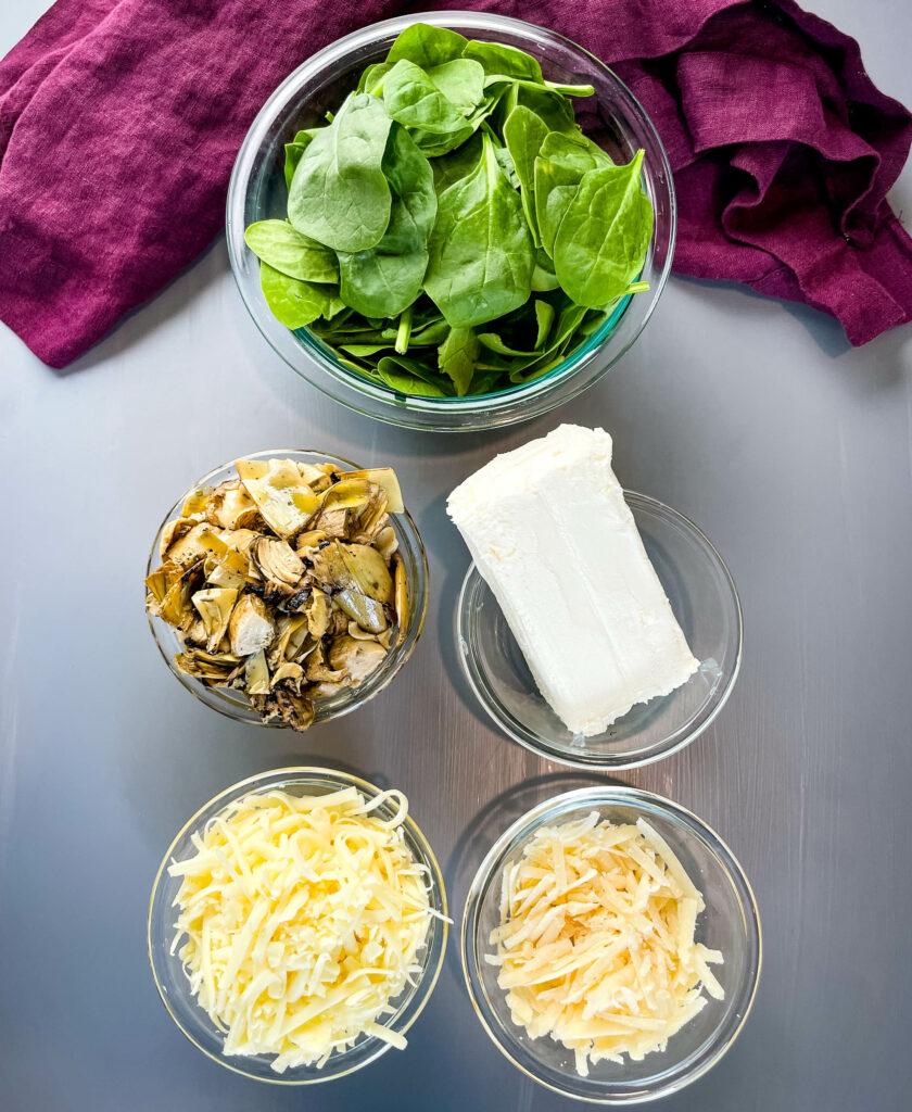 fresh spinach, artichokes, cream cheese, mozzarella, and Parmesan in separate bowls