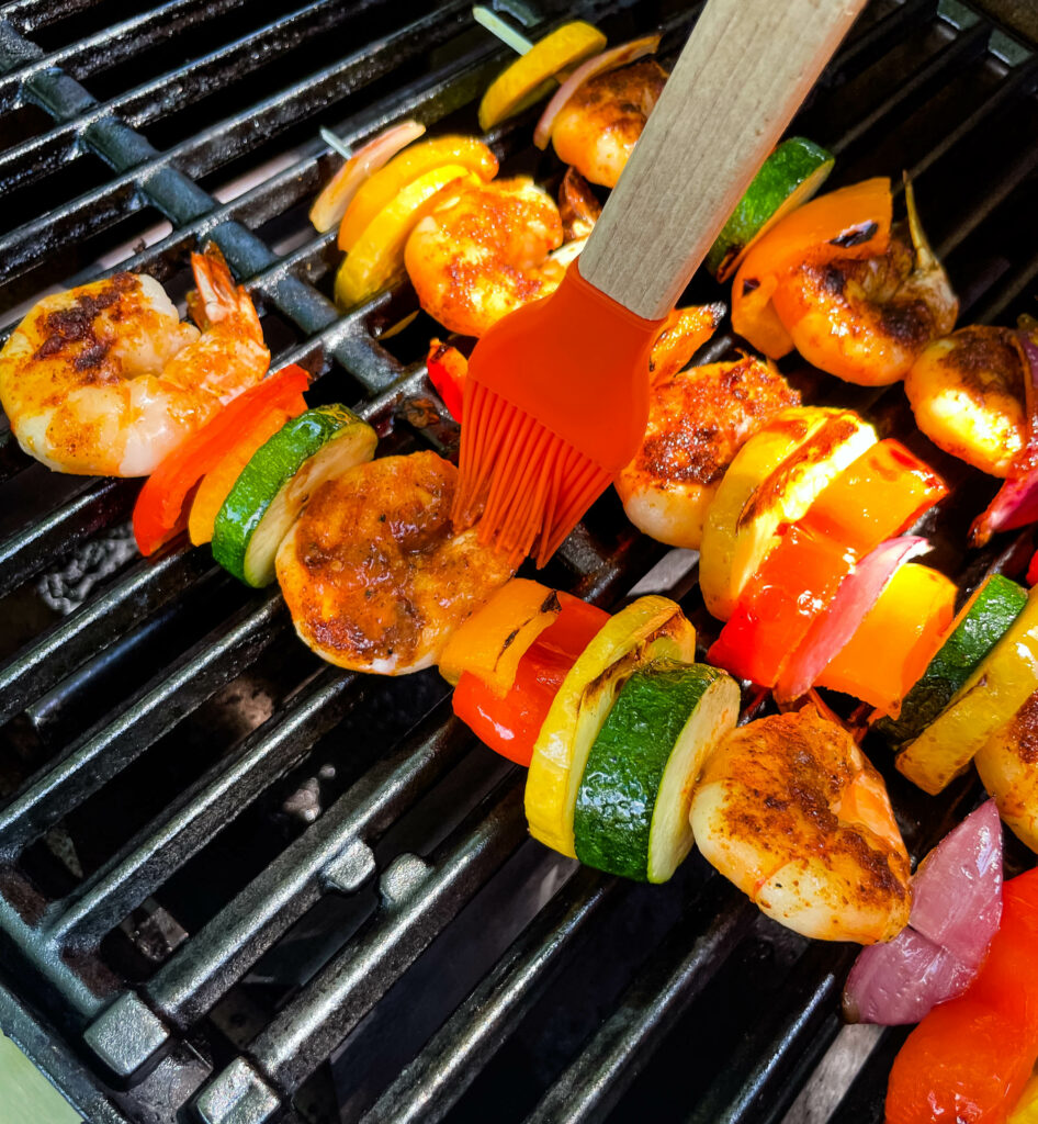 BBQ grilled shrimp skewers on a grill