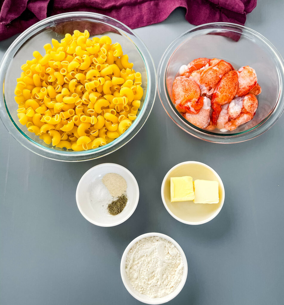 macaroni pasta, raw lobster, butter, flour, and seasonings in separate bowls