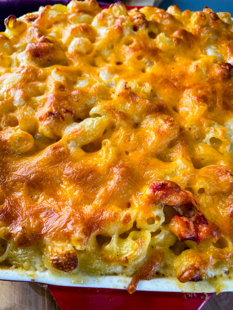 close up view of lobster mac and cheese in a baking dish