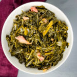 southern collard greens in a white bowl