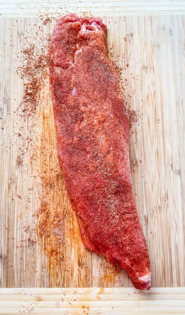 seasoned pork tenderloin on a cutting board