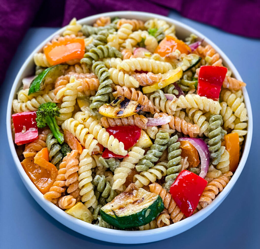 vegetable pasta salad in a white bowl