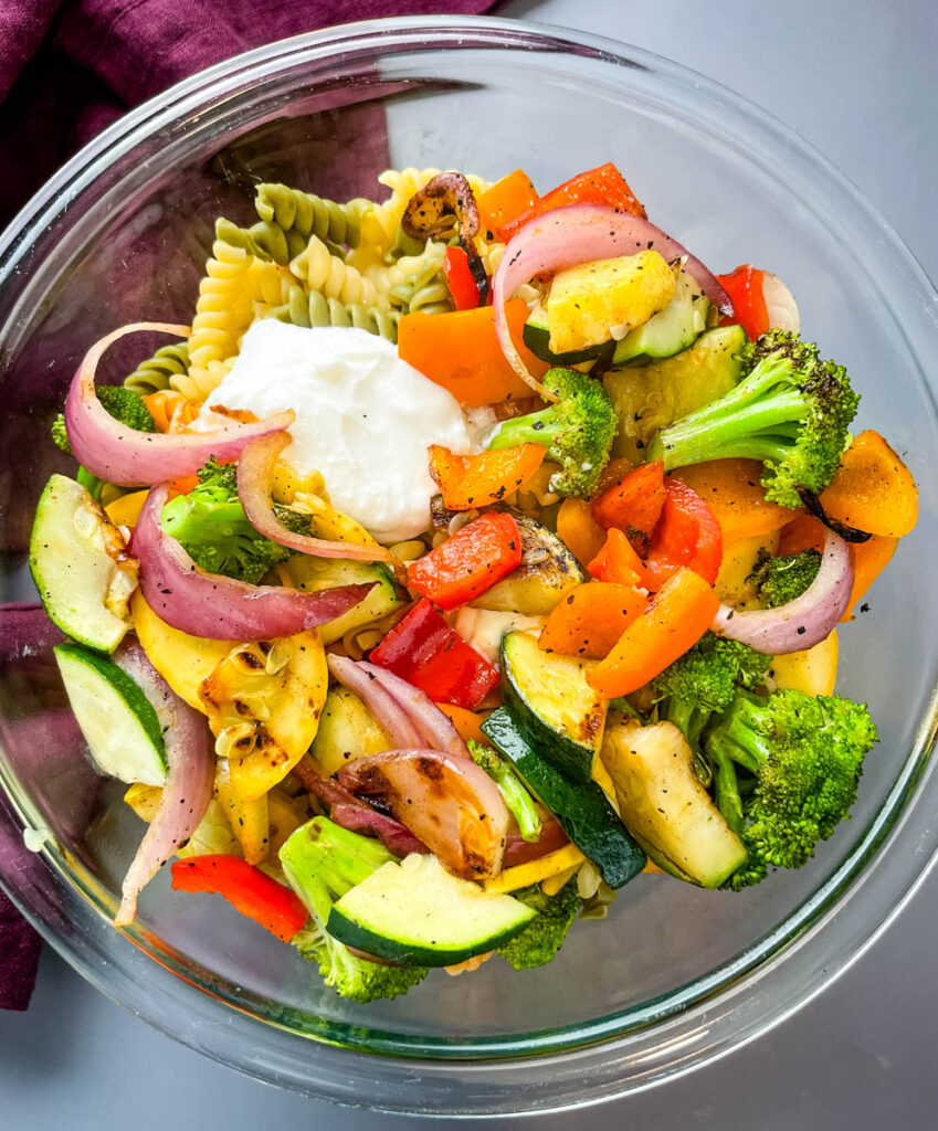vegetable pasta salad in a glass bowl