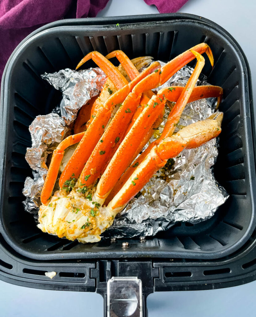 crab legs in an air fryer with foil