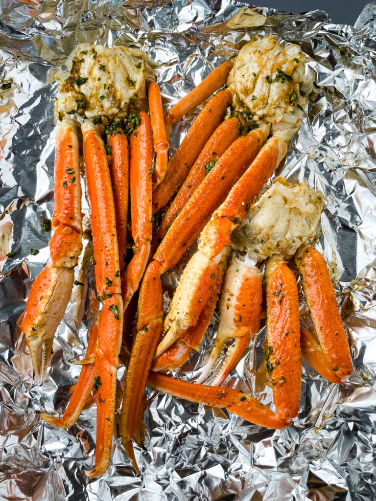 fresh crab legs on foil with garlic butter