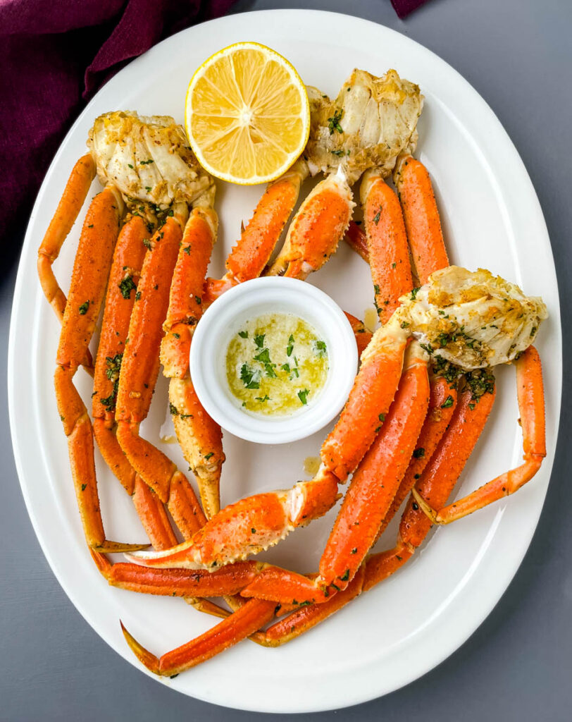 air fryer crab legs on a white plate with butter