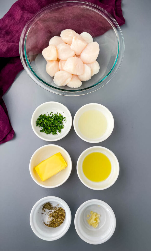 raw scallops, chopped parsley, butter, olive oil, and lemon juice in separate bowls